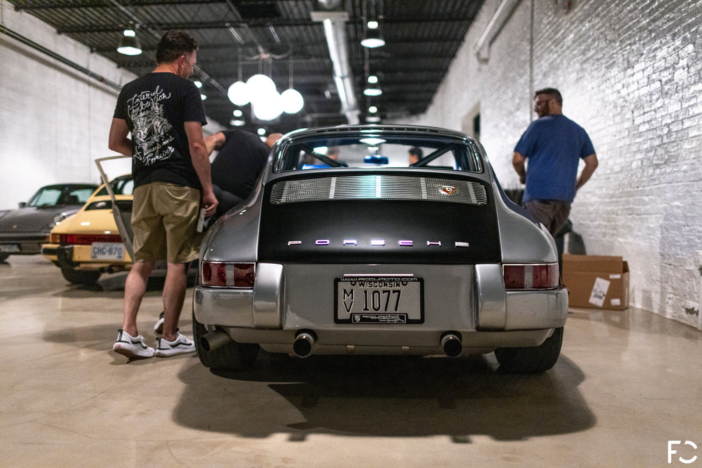 Rear view of Mark White from Accumoto's Porsche 911 nicknamed Pepe