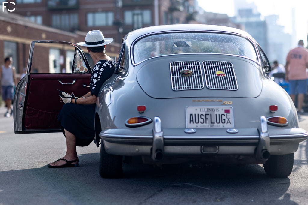 Rear photo of Porsche 356 with owner arriving at Checkeditout Chicago 2021
