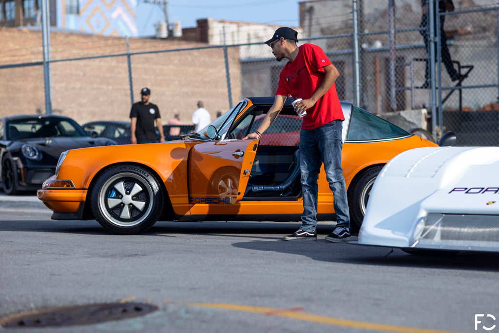 Side photo of an Orange 911 Targa parked in downtown Chicago for Checkeditout 2021