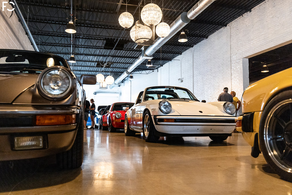 Porsches parked inside Revel event space in downtown Chicago for Checkeditout 2021