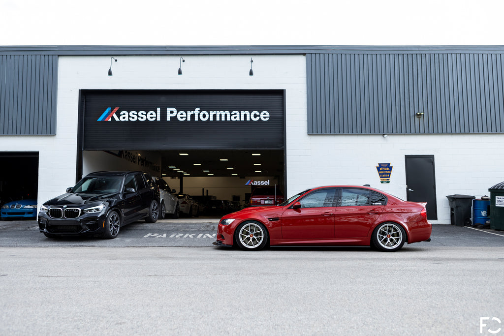 Future Classic E90 M3 parked outside of Kassel Performance shop entrance