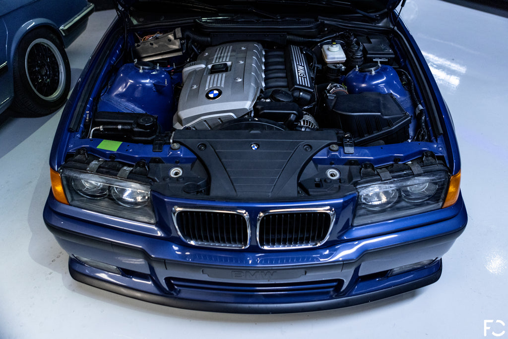 overhead view of N52 engine inside blue BMW 318ti at Kassel performance