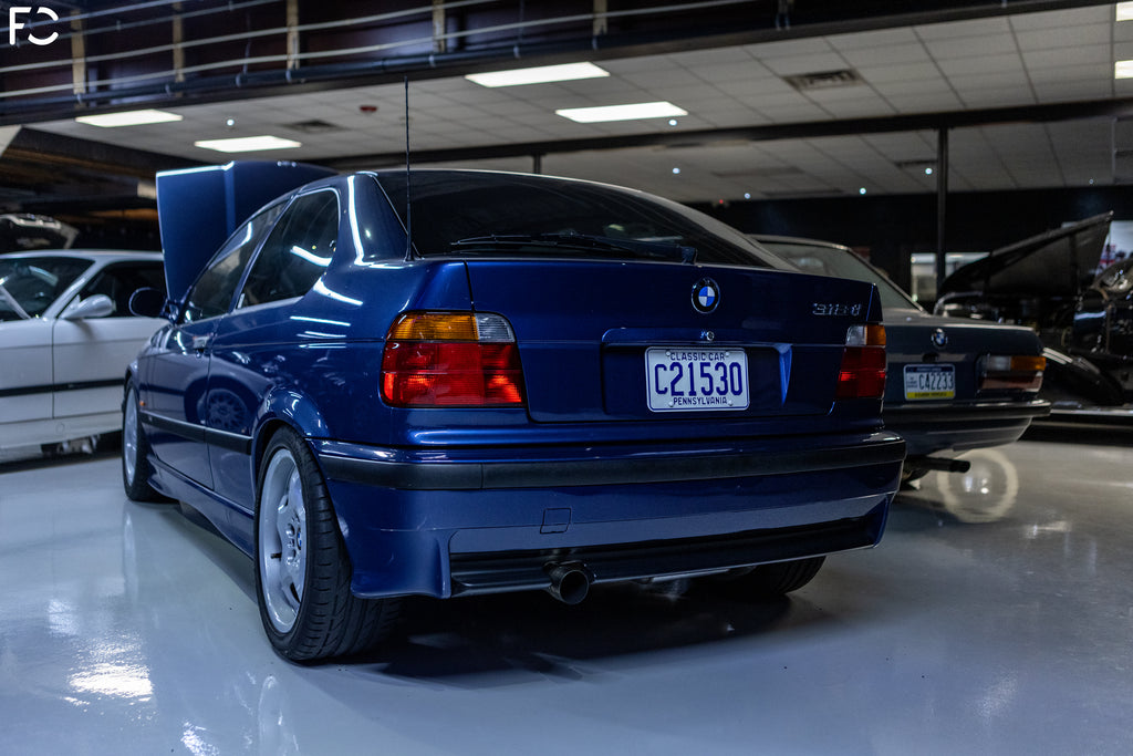 rear low angle view of blue bmw 318ti at Kassel performance