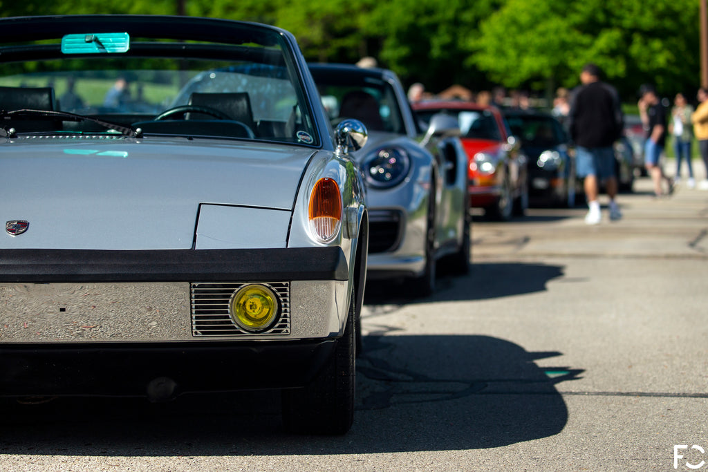 CheckeditOut Chicago: Porsche 914 front end with other cars cascading behind