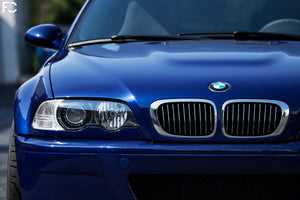 Straight on view of BMW chrome kidney grille set on Interlagos Blue E46 M3