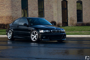 Angle view of BMW chrome kidney grille set on Jet Black E46 M3