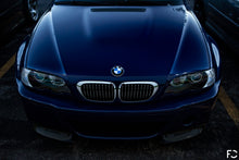 Load image into Gallery viewer, Overhead view of BMW chrome kidney grille set on Interlagos Blue E46 M3