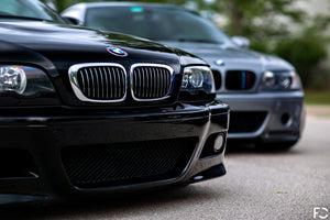 BMW chrome kidney grille set shown on Jet Black E46 M3
