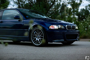 Angle view of BMW chrome kidney grille set on Interlagos Blue E46 M3