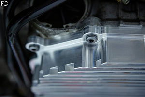 Fall-Line Motorsports Aluminum DCT Oil Pan - raw prototype pan closeup showing OEM hardware