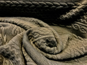 Grey/Olive Green Textured Faux Cable knit 93% Polyester 5% Rayon 2% Spandex.    1/4 Meter Price