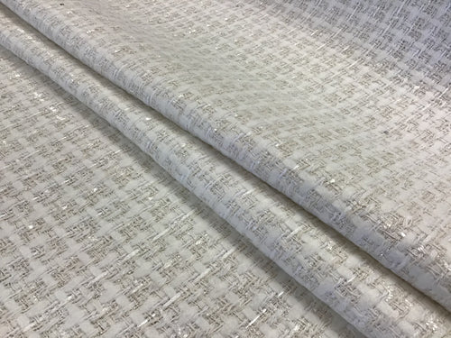 White/Ivory Couture Tweed  35% Wool 15% Acrylic 15% Polyester 10% Mohair 10% Alpaca 10% Cotton 5% Other