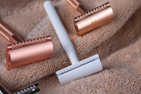 Best Options Safety Razor is Black and White, shown on cloth