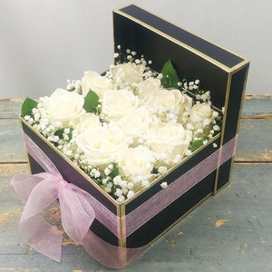CLASS ACT (ONE DOZEN WHITE ROSES IN PRESENTATION BOX)