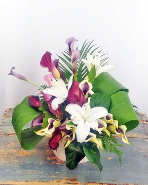 SYMPHONY OF LILIES BASKET