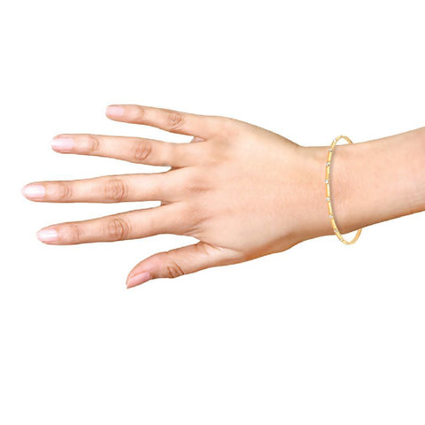 Gold bangle with rhodium dots