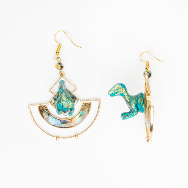 green iridescent T-rex red dinosaur earrings on geometrical shape