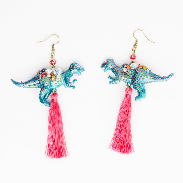 green iridescent T-rex red dinosaur earrings with fuchsia pink tassels