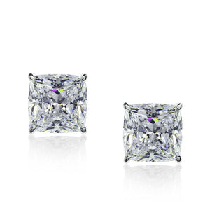 9K White Gold Stud Earrings - Cushion cut stones in martini setting