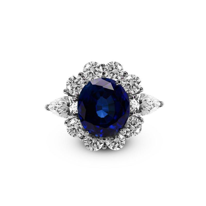 Sterling Silver Sapphire Ring - Sapphire encased with white stones