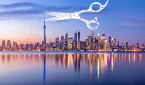 The city of Toronto skylines and a pair of hairdressing scissors