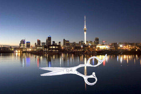 The city of Auckland in New Zealand with a pair of hairdressing scissors