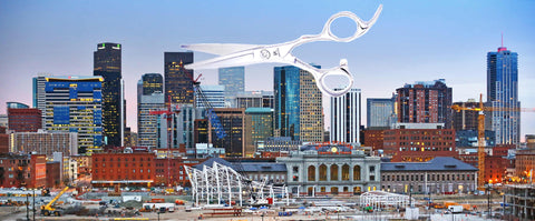 The city of Denver, Colorado, with a pair of hairdressing scissors in the background