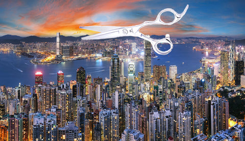 The city of Hong Kong with a pair of hairdressing scissors