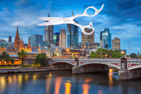 Melbourne city with a pair of hair cutting scissors above the skyline