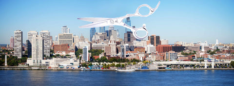 The skyline of the city of Philadelphia, USA with a pair of hairdressing scissors