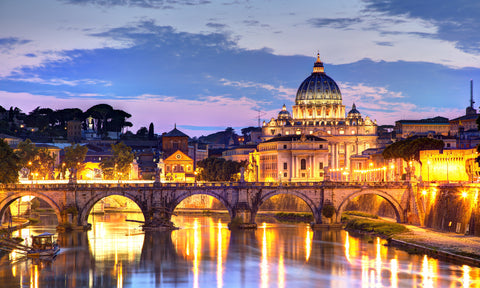 The city of Rome at night in Italy