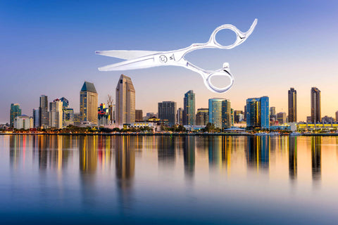 Hairdressing scissors above San Diego city