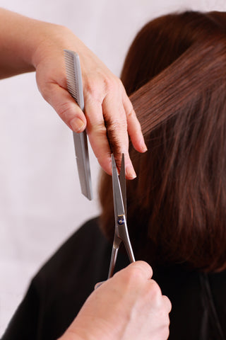 Scissor over comb haircutting