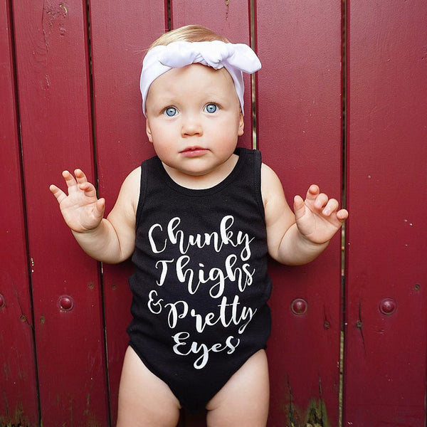 Chunky Thighs & Pretty Eyes Baby Onesie -  Hipster Kids Style. Youth Clothing and apparel Outfitters for hipster kids, toddlers, and babies.