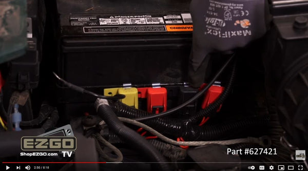 Fuses on harness secured to battery crossbracket