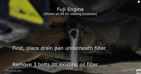 Drain oil, remove three bolts from filter