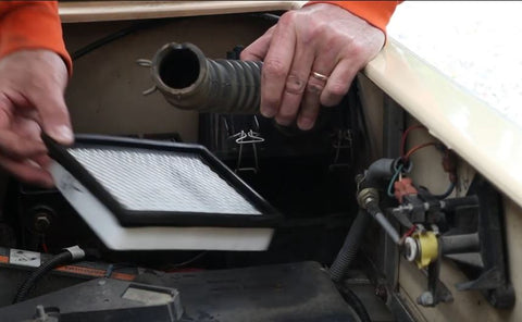 remove old filter from Club Car Golf Cart