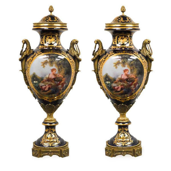 7712-82179CA A720201 Pair Of Hand-Painted Dark Blue & Gold Porcelain Vases with European Figures and Bronze Accents (11L X 9W X 24H)