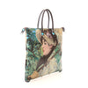 Large Convertible Hand Bag featuring Manet's Jeanne (Spring) by Gabs, Italy-side view | Getty Store