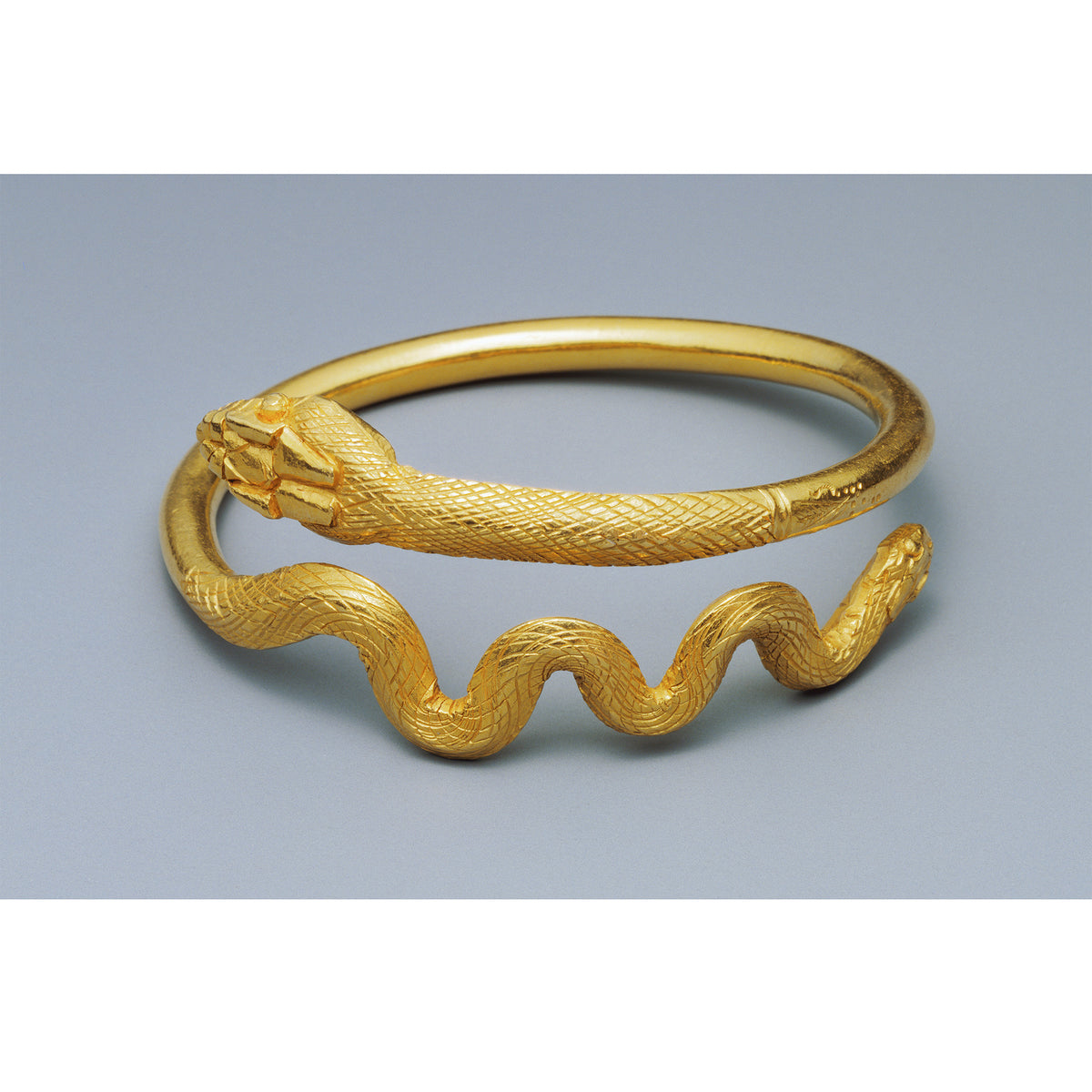 Snake Bracelet- Silver Plated -Original gold snake bracelet which inspired the silver snake bracelet | Getty Store