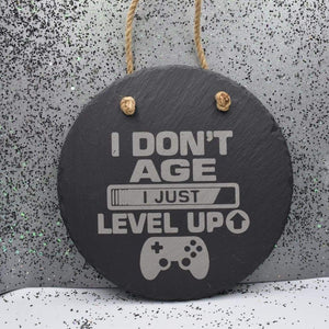"Hanging Slate 7 3/4"" Round - Gamers Don't Age - Hanging Slate 7 3/4"" Round - Gamers Don't Age - Gamer, Gift, Hanging Decor, Laser Engraved, Slate, Video Games"