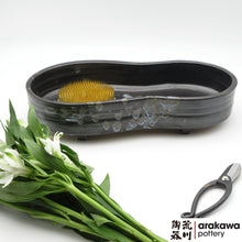 Load image into Gallery viewer, Black Glaze with Blue Splash Suiban for Moribana Ikebana container made of Bravo Buff Stoneware by Thomas Arakawa and Kathy Lee at Arakawa Pottery