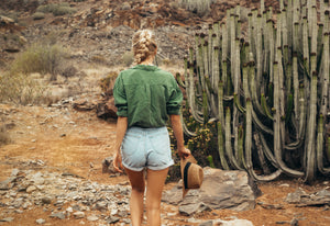 girl walking through cactus field with healthy hair