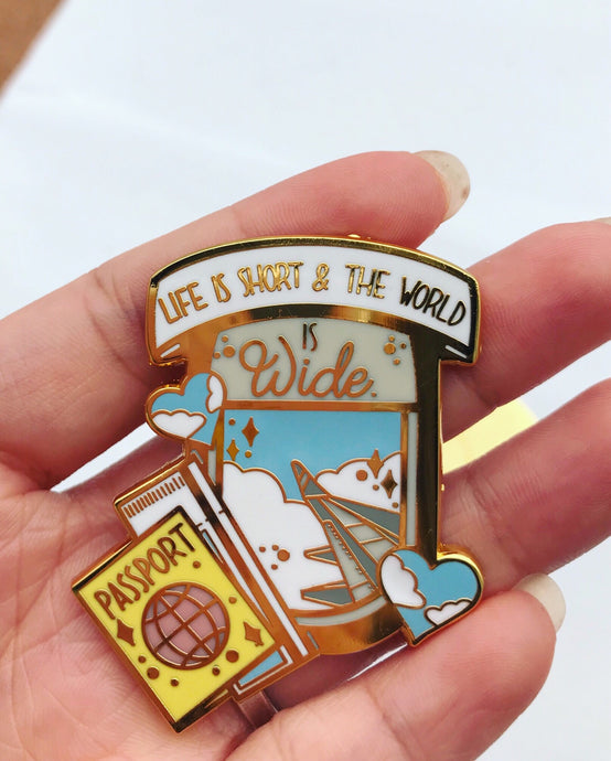 The World Is Wide Enamel Pin