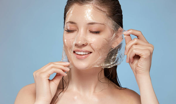 woman removing sheet mask