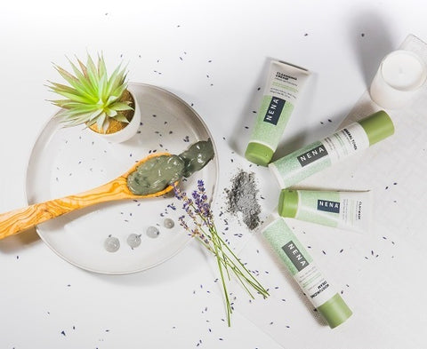 Nena glacial skincare products flat lay with clay on wooden spoon and lavender