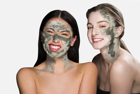two women with clay masks