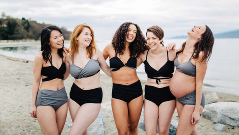 Five women in Nettle's Tale Swimwear on a beach in Vancouver