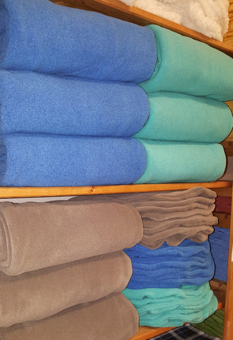 fleece blankets on the shelves at massage therapy supply outlet