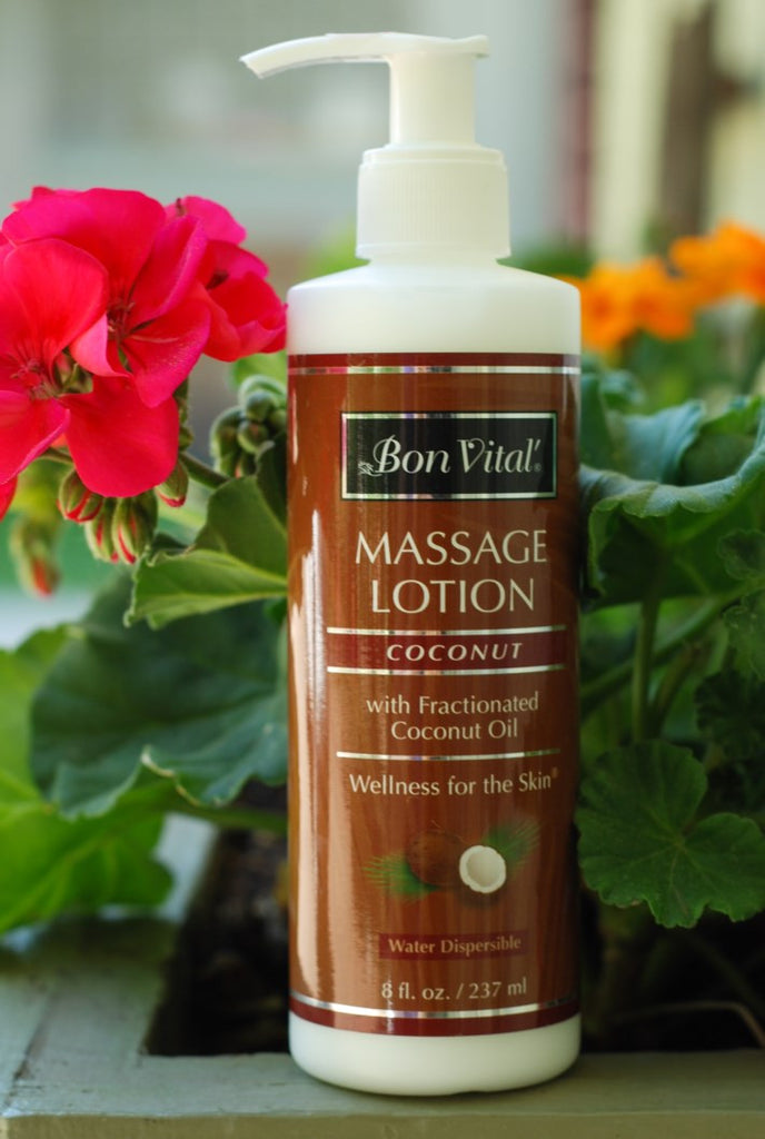Bon Vital coconut massage lotion with pump, in front of flower box at massage therapy supply outlet store